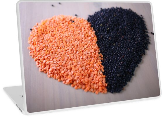 Red and black lentils forming a valentine heart shape for healthy living  by PhotoStock-Isra
