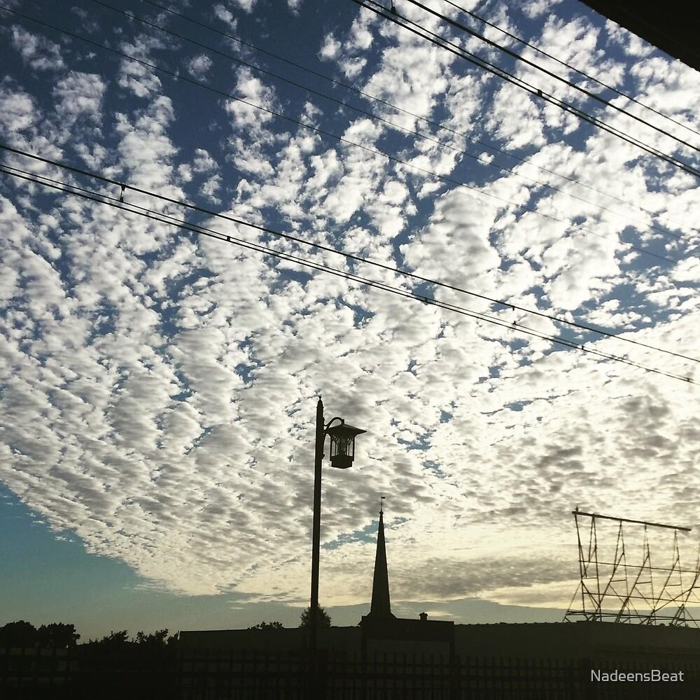 Morning Commute sky by NadeensBeat