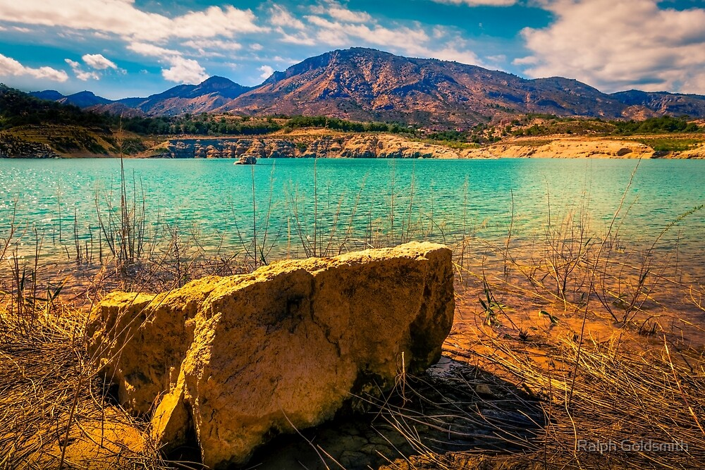 The rock and the mountains at Amadorio by Ralph Goldsmith
