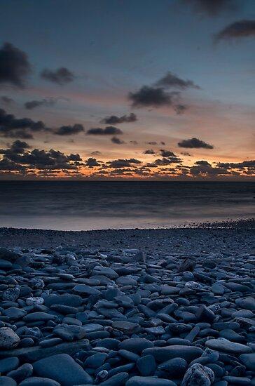 Pebble Sunset by HenryGeeVee