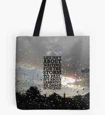 Life isn't about Waitin for the storm to pass. It's about Learning to Dance in the Rain Tote Bag
