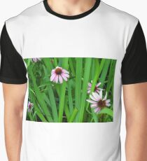Pink large flowers in the grass. Graphic T-Shirt