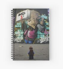 The Lego Backpacker checking out street art in London Spiral Notebook