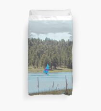 Boat on Lake Mary Duvet Cover