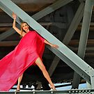Naked Glamour Model dressed only in Red fabric at the the Bridge constructions by Anton Oparin