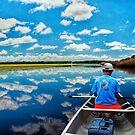 Cloud reflection on a lake by Joe Saladino