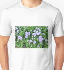 Purple flowers, natural background  T-Shirt