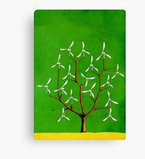 Wind turbine blades on a tree Canvas Print