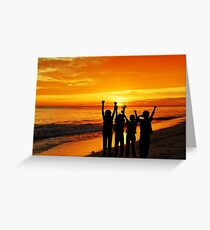 Children silhouettes on a  sunset beach Greeting Card
