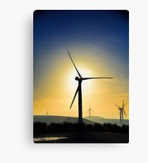 Wind Turbine silhouetted by the rising sun Canvas Print