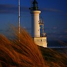 Lighthouse at sunset by Sue Conway