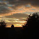 Sunset Over Houses by Richard Winskill