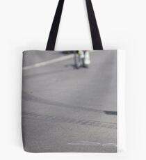 Cyclist on the road Tote Bag