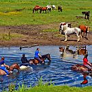 Horse riding in a river, near Ogmore Castle, Wales by Remo Kurka