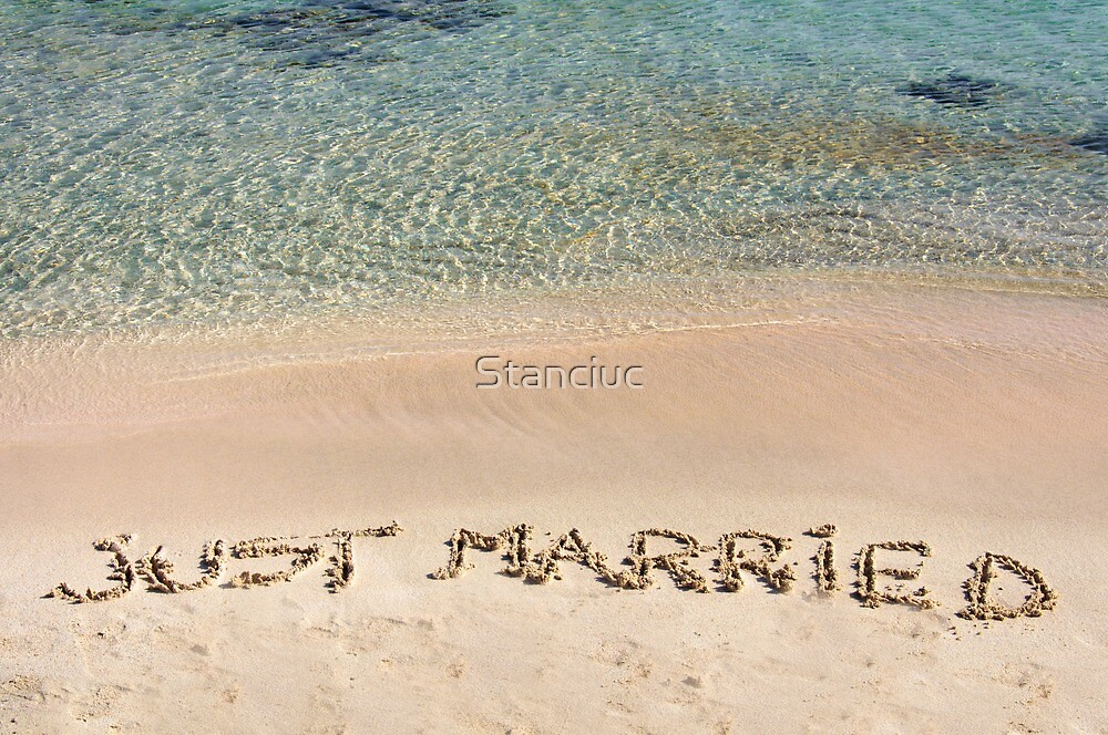 Just Married written in sand on a beautiful beach by Stanciuc