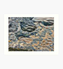 Eroded rocks on beach with puddle Art Print