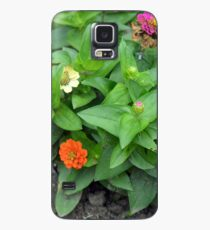 Colorful pink and orange flowers in green leaves bush in the garden. Case/Skin for Samsung Galaxy