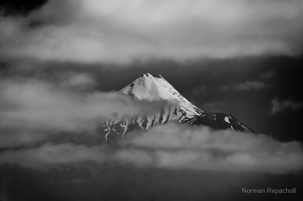 Taranaki amongst the clouds, New Zealand by Norman Repacholi