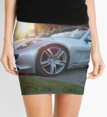 2012 Fisker Karma electric supercar against a sunset Mini Skirt