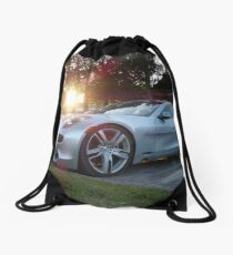 2012 Fisker Karma electric supercar against a sunset Drawstring Bag