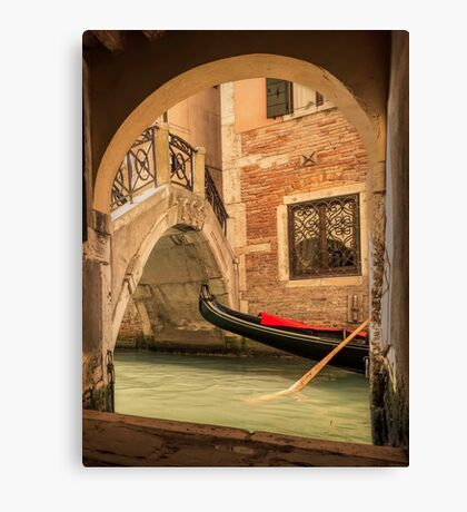 Venice gondola through the arch Canvas Print