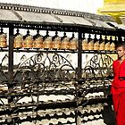 Prayer bells and monk by indiafrank