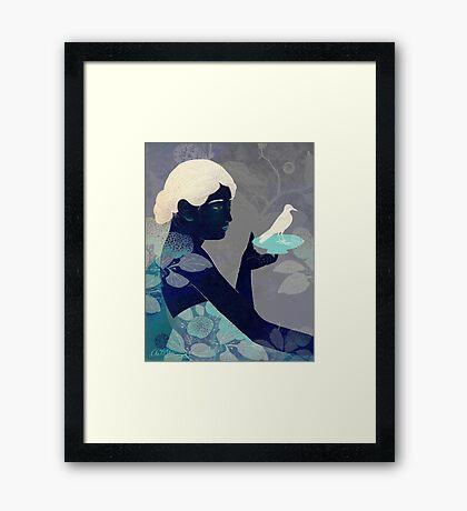 Bird on a plate Framed Print