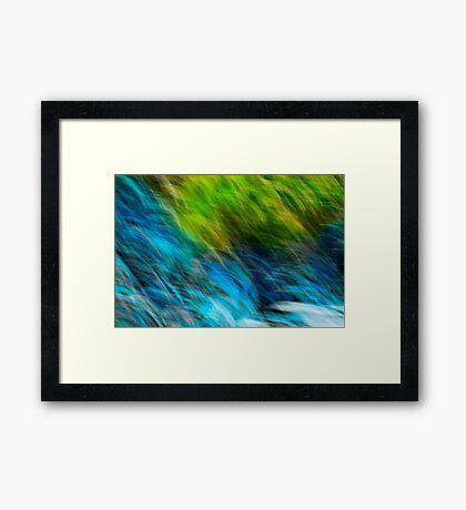 Splashing down the rocks Framed Print