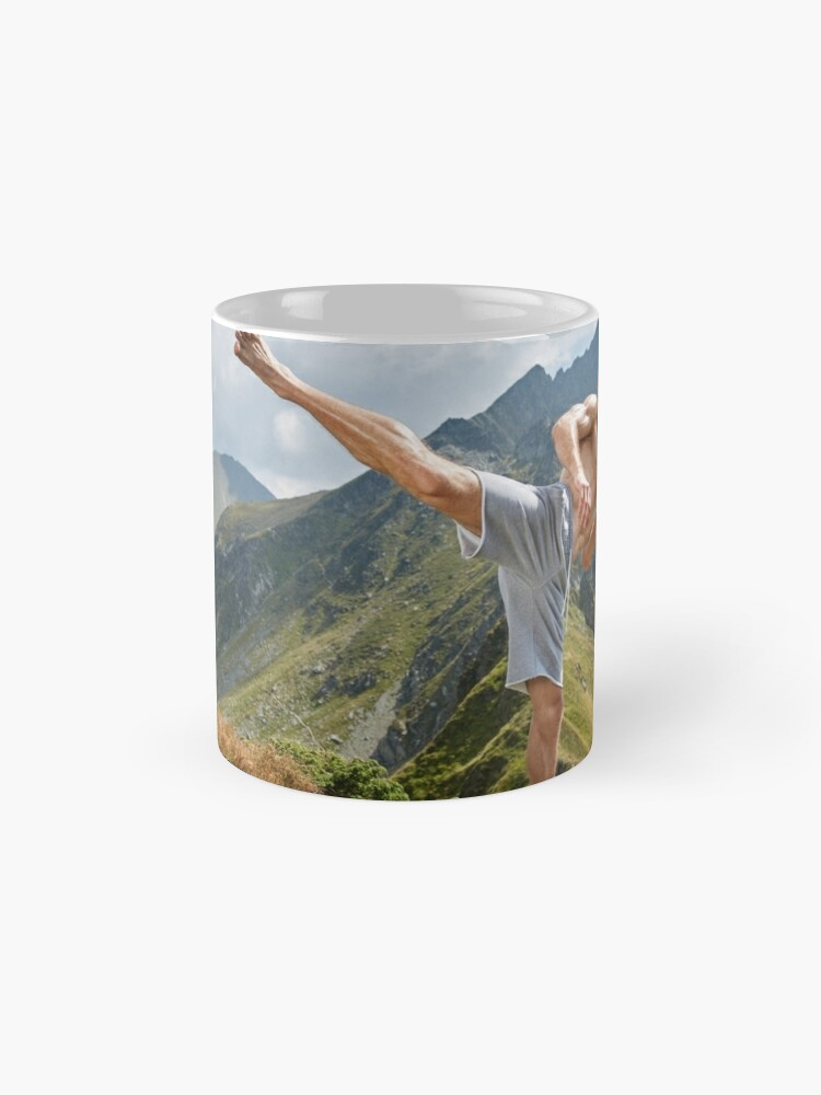 Alternate view of Kickboxer or muay thai fighter training on a mountain Mug