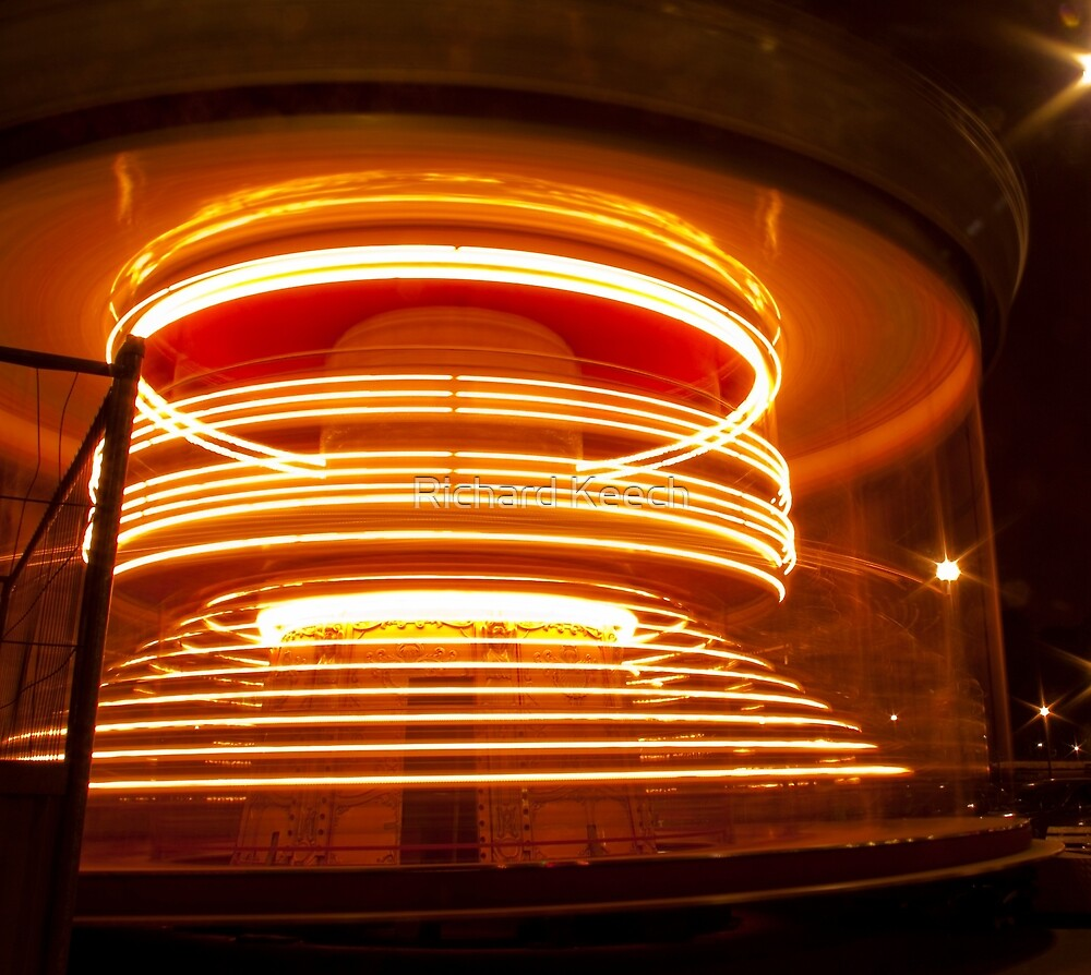 Merry-go-round and round and round! by Richard Keech