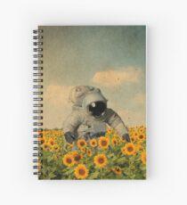 astronaut in a sunflower's field Spiral Notebook