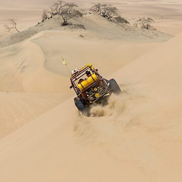 Dune buggy with passengers speeding across the side of a large dune by cannboys