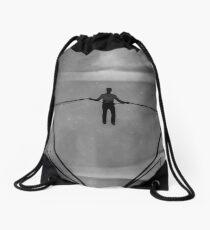 The Amazing Gravity Defying Man - Brighton - England Drawstring Bag