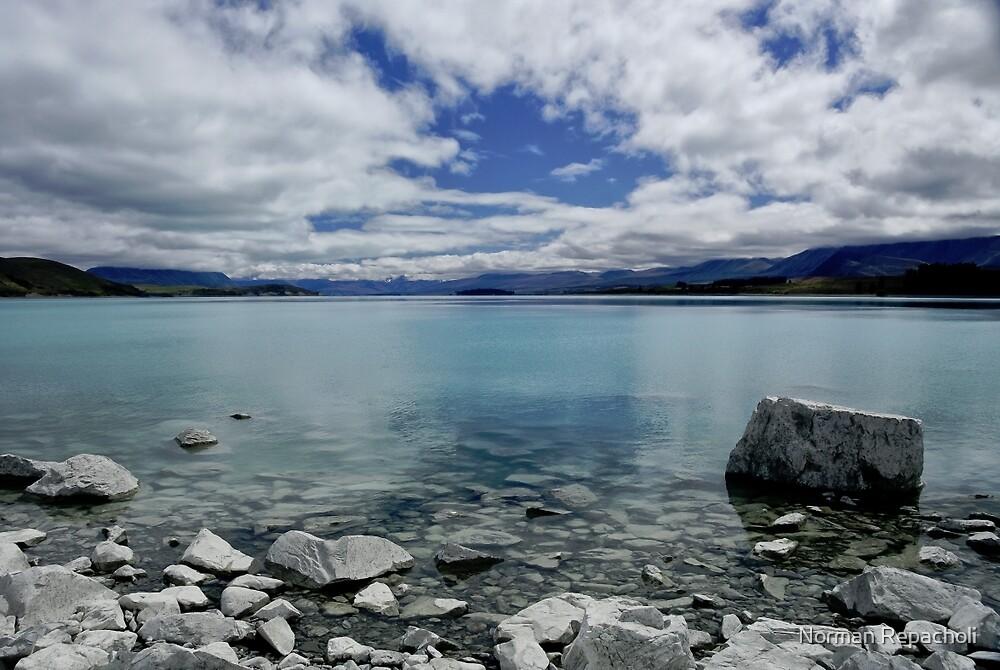 Into Lake Tekapo, New Zealand by Norman Repacholi