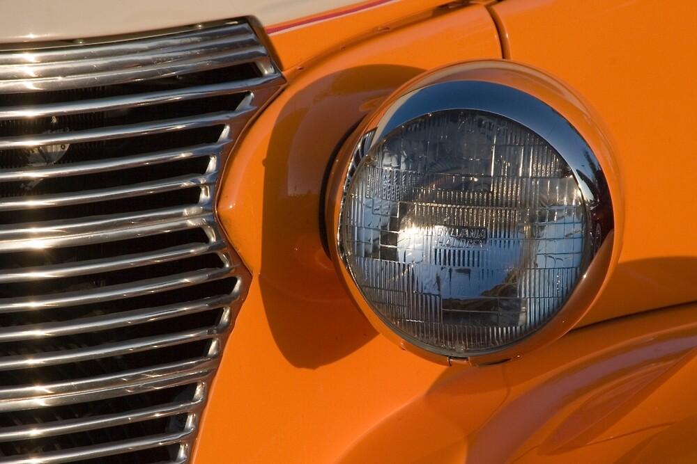 orange fender classic car by David Chesluk