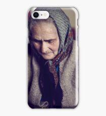 Closeup of an old sad woman indoor iPhone Case/Skin