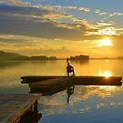Drifting Fisher Watching Sunset over a Lake by Remo Kurka