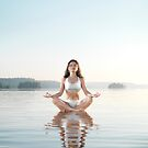 Woman practicing morning sunrise meditation on the water art photo print by ArtNudePhotos