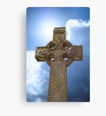 sunshine over celtic cross at ancient graveyard Canvas Print