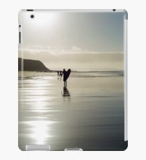 surfer and people silhouette out on the beach iPad Case/Skin