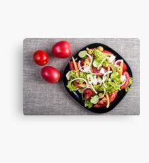 Top view of a small plate of salad made from natural raw vegetables Canvas Print