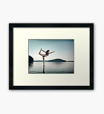 Woman practicing yoga on platform in the water doing Dancer pose art photo print Framed Print