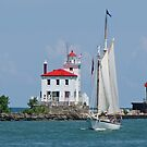 Lighthouse With Tall Ship by Jack Ryan