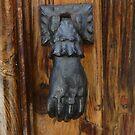 Brass hand door knocker by sledgehammer
