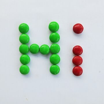 """the word """"Hi"""" made by chocolate mm candy by newbietraveller"""