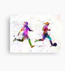 Girls playing soccer football player silhouette Canvas Print