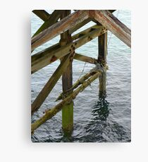 The old pier at Trefor Canvas Print