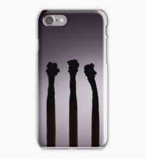 Silhouettes of burnt matches on vignetting background iPhone Case/Skin