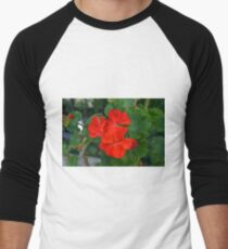 Red powerful color flower and green leaves background. T-Shirt