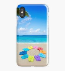 Color flip flops and drawing sun on sandy beach iPhone Case/Skin